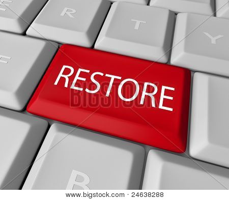 A keyboard with a red key for the word Restore, representing the need to return to past values or recover files lost on a computer through a back-up copy