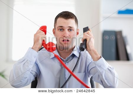 Businessman overextended with the telephone