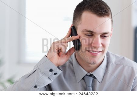Concentrated businessman listening closely to caller