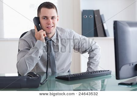 Businessman listening carefully to caller on the phone