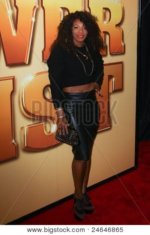 "NEW YORK - OCTOBER 24: Serena Williams attends the premiere of ""Tower Heist"" at the Ziegfeld Theatre on October 24, 2011 in New York City."