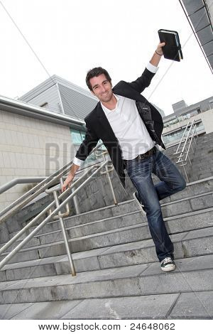 Man running downstairs with stretched arms