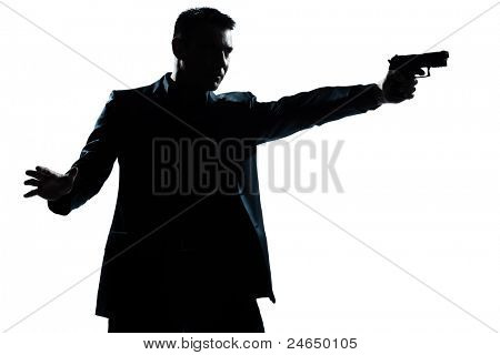 one caucasian man with gun aiming portrait silhouette in studio isolated white background
