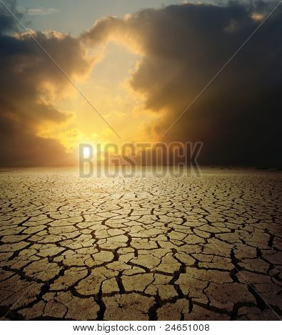 sunset over barren land