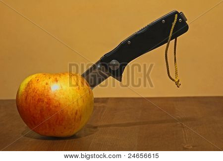 Apple With A Knife Stuck In It.