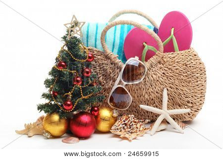 Beach accessories and Christmas tree on white background.