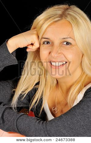 Beautiful woman portrait smiling. isolated over a black background.