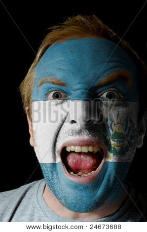 Face Of Crazy Angry Man Painted In Colors Of El Salvador Flag