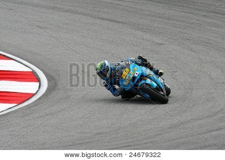 SEPANG, MALAYSIA - OCTOBER 22: MotoGP rider Alvaro Bautista competes at the qualifying session of the Shell Advance Malaysian Motorcycle Grand Prix 2011 on October 22, 2011 at Sepang, Malaysia.