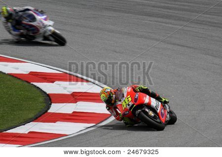 SEPANG, MALAYSIA - OCTOBER 22: MotoGP rider Valentino Rossi (46) competes at the qualifying session of the Shell Advance Malaysian Motorcycle Grand Prix 2011 on October 22, 2011 at Sepang, Malaysia.