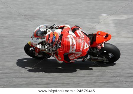 SEPANG, MALAYSIA - OCTOBER 23: Moto2 rider Stefan Bradl warms up on race day of the Shell Advance Malaysian Motorcycle Grand Prix 2011 on October 23, 2011 at Sepang International Circuit, Malaysia.