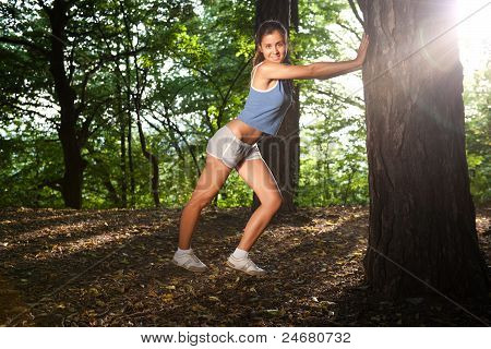 Beautiful Young Woman Stretching In A Forrest After Training