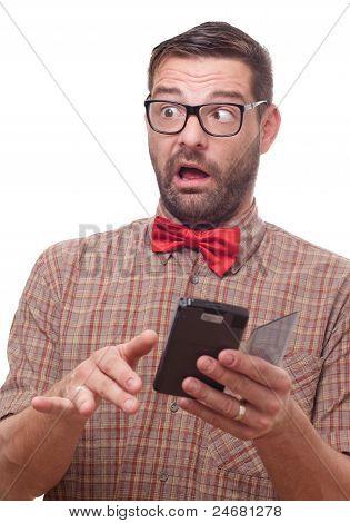 Surprised Cross-eyed Geek Using A Gadget