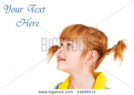Portrait of a funny red haired little girl looking up