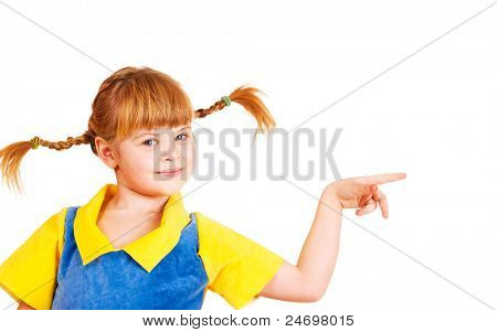 Cute little girl with funny braids pointing to the right