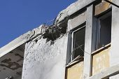 Hole and broken windows in the apartment building caused by explosion of missile launched by Hamas t