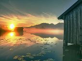 Amazing Misty Morning Lake,  Typical  Old Wooden Dock House With Poles On Lake And Wooden Pier. Koch poster