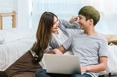 Closeup Happy Asian Lover Or Couple Talking And Smiling When Using Technology Laptop On The Bed In B poster