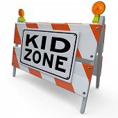 image of barricade  - An orange and white construction barricade sign blocking an area that is a designated Kid Zone where children can safely gather and play or learn in an outdoor park or school classroom - JPG