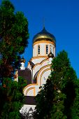 White Christian Church With Golden Domes At Sunny And Clear Summer Day Amidst The Greenery, Thuja Tr poster