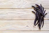 Beans Of Purple Beans On A Wooden Background. Spinach Beans. Asparagus Beans poster