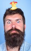 Hipster Shocked Face With Apple Stump Target On Head Blue Background, Close Up. Weight Loss Goal. Ma poster
