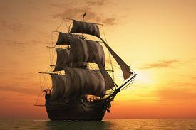 stock photo of sailing vessels  - Vintage sailboat vmore at sunset - JPG