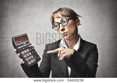 Businesswoman indicating a calculator