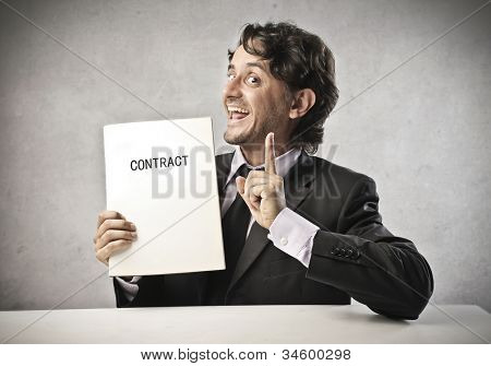 Smiling businessman holding a contract