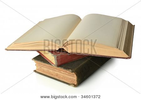 Stack on old vintage books with open one on top isolated over white background