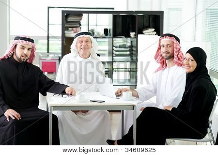 Arabic elderly business with his team at office