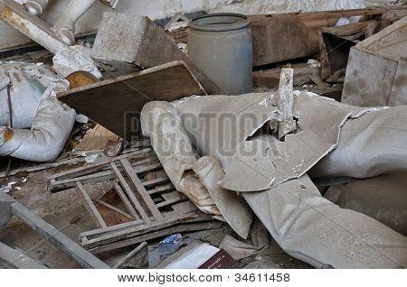 Broken Statues In Vandalized Interior