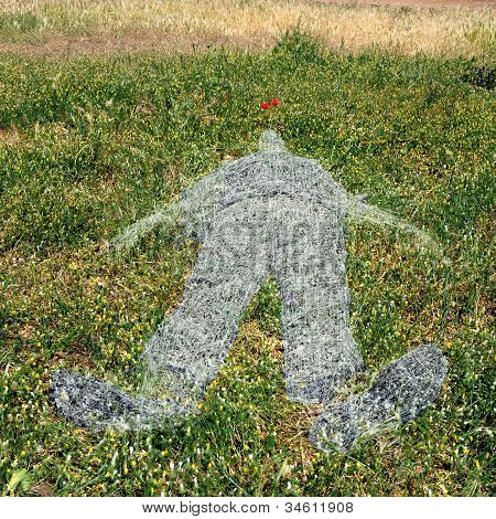 Human Figure Imprinted On Grass
