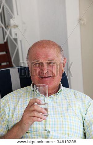 Healthy Happy Pensioner Drinking Water