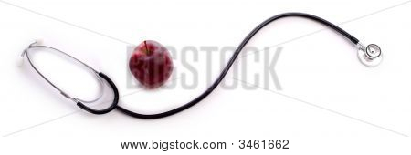 A Stethoscope And Apple On White