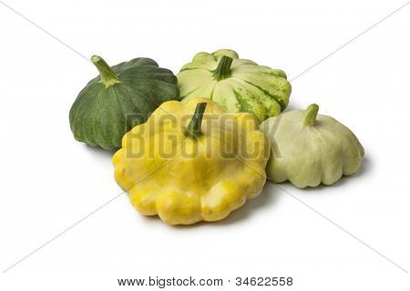 Different types of  Patty pan Squashes on white background