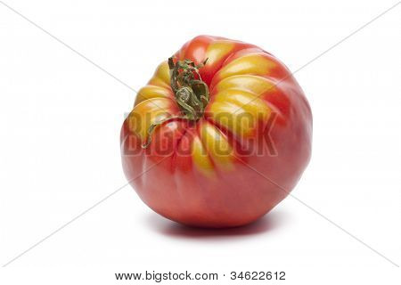 Single Coeur de Boeuf tomato on white background