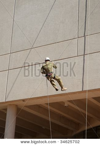 abseiling down the wall