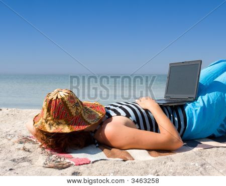 Girl Sleep With Laptop Computer At Sea Beach