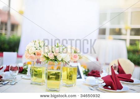 Outdoor banquet wedding table setting, shallow depth of field