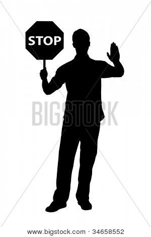 A silhouette of a full length portrait of a man gesturing and holding a traffic sign stop isolated on white background