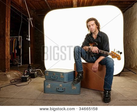 Musician With Guitar In Studio