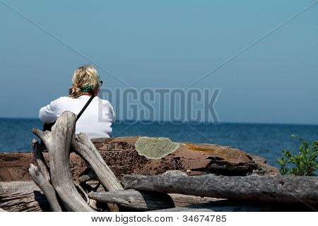 woman enjoying lake superior
