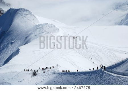 Snow Slope With Mountain-Skiers, The Alps