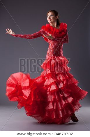 young woman flamenco dancer posing in red