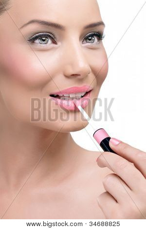 Young attractive woman applauding glossy on her lips