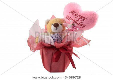 Happy birthday teddy bear with a pink hearth balloon