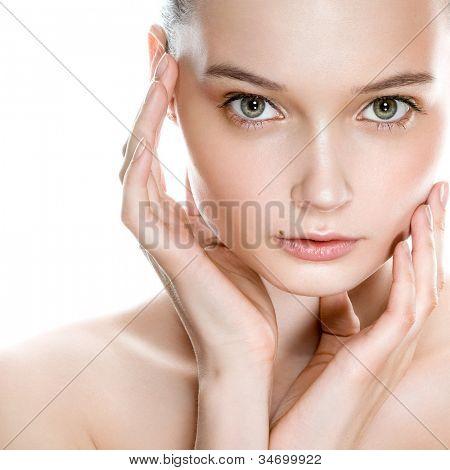 Beautiful young woman face with natural looking makeup