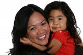 stock photo of mother daughter  - cute little girl and attractive young woman hugging tightly - JPG