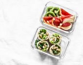 Healthy Diet Food Lunch Box - Fruit And Chicken, Beans, Green Salad Pita Bread On A Light Background poster